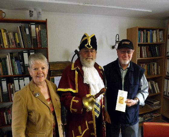 USA visitors talking to Redruth Town Crier (George Saint) in our offices.